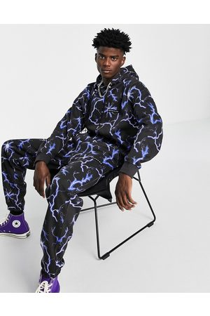 Mennace Men Joggers - Trackies in with all-over lightning print (Part of a co-ord)