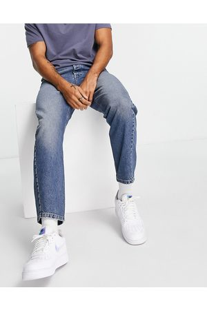 Topman Curved leg taper jeans in mid wash