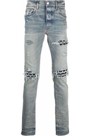 AMIRI X Playboy ripped-effect skinny jeans