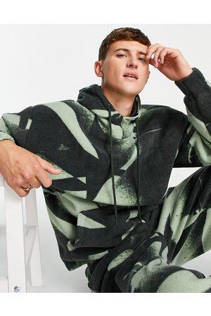 ASOS Co-ord polar fleece oversized hoodie in all-over camo print