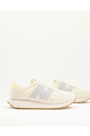 New Balance 237 mesh sneakers in and grey-White