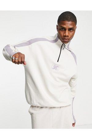 ASOS Oversized half zip sweatshirt in purple colour-block with chest print-Neutral