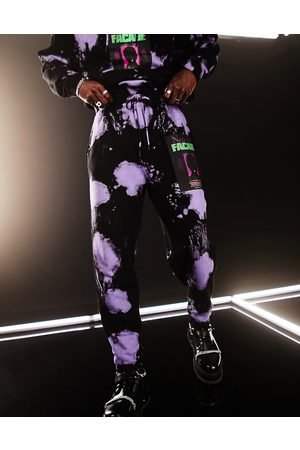 ASOS Co-ord oversized trackies in black and purple tie dye with text print-Multi