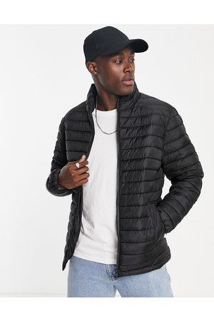 SELECTED Quilted jacket made from recycled bottles in