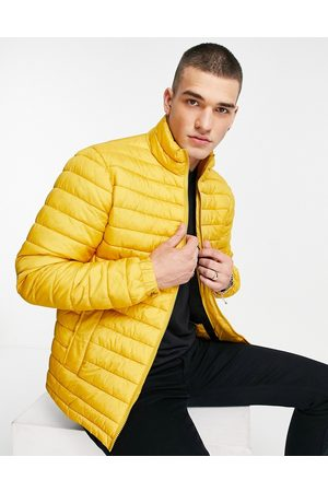 SELECTED Quilted jacket made from recycled bottles in yellow