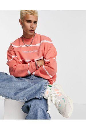 ASOS Oversized sweatshirt in tie dye with text print