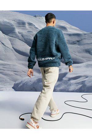 ASOS Oversized teddy borg sweatshirt with logo embroidery