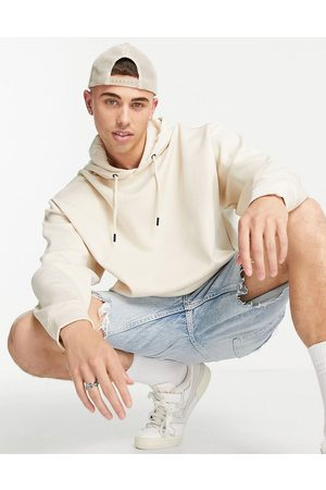 ASOS Oversized clean Scuba hoodie in beige with roman numerals-Neutral