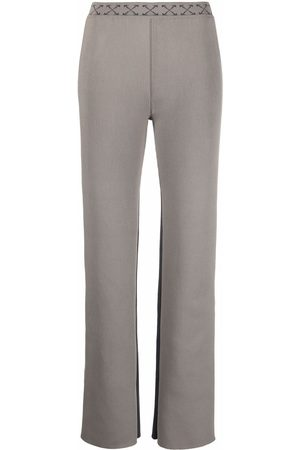 OFF-WHITE Arrow-waistband trousers