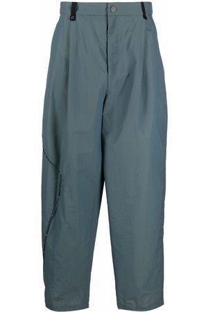 A BETTER MISTAKE Asymmetrical drawstring wide-leg trousers