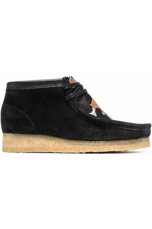 Clarks Wallabee cow-print boots