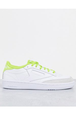 Reebok Club C 85 sneakers in with yellow detail