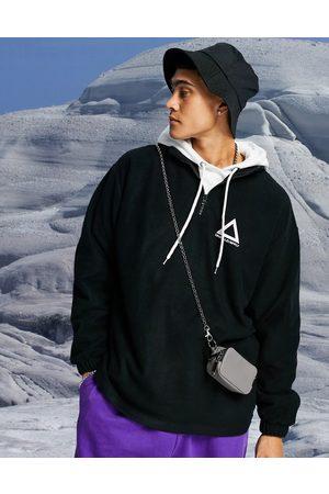 ASOS Oversized half-zip sweatshirt in polar fleece with logo print