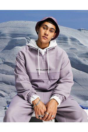 ASOS Oversized polar fleece halfzip sweatshirt with nylon pocket & logo print-Purple