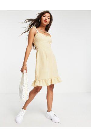 Urban Threads Tie strap satin mini dress in gingham-Brown