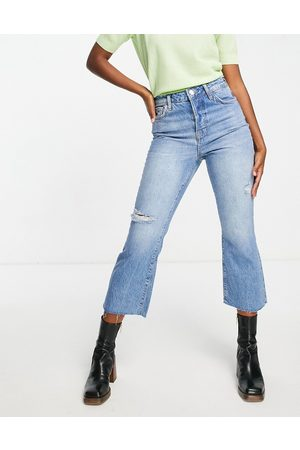 River Island High waisted ripped kick flared jeans in medium blue