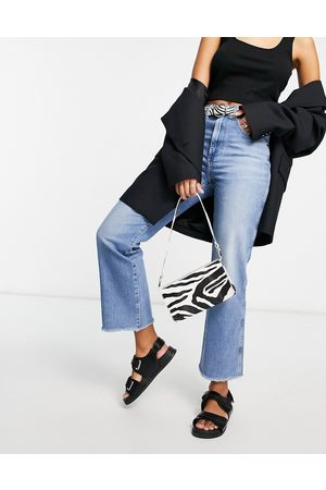 Wrangler Cropped raw hem mom jeans in mid wash-Blue