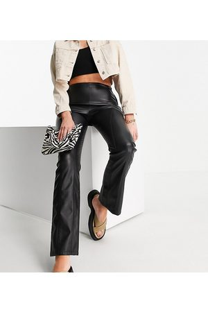 ASOS ASOS DESIGN Tall low-rise leather-look seamed flare pants in