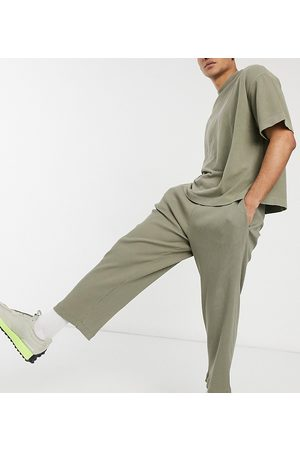 COLLUSION Relaxed tapered track pants in heavy compact rib fabric in co-ord-Green