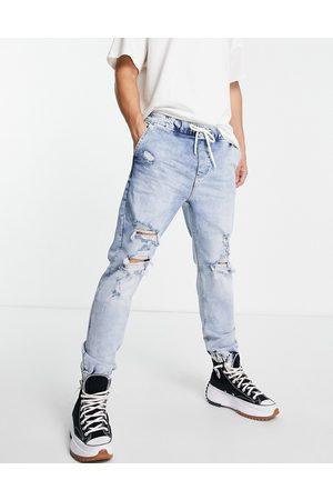 Bershka Tapered jeans in mid blue