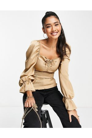 ASOS DESIGN Satin long sleeve top with shirred waist in