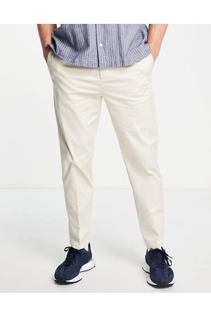 River Island Tapered pleated chinos in stone-White