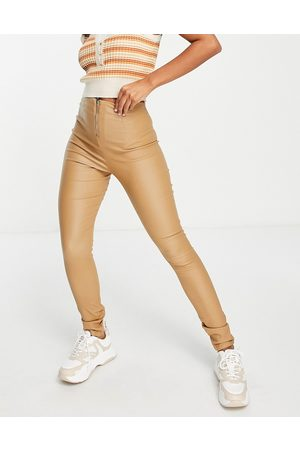 VILA Coated leggings with zip back in -Brown