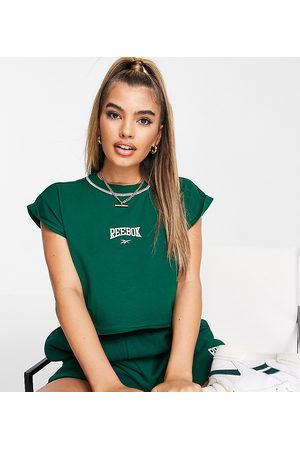 Reebok Women Crop Tops - Basketball drop shoulder crop top with raw hem in green Exclusive to ASOS