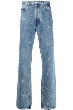 MARTINE ROSE All-over logo print jeans