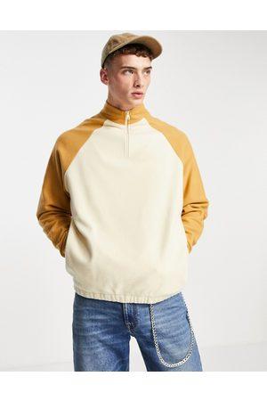ASOS Oversized polar fleece half zip sweatshirt with contrast sleeves-Neutral