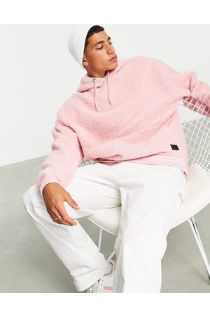 ASOS Oversized hoodie in teddy borg with badge-Pink