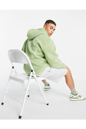 ASOS Oversized hoodie in teddy borg with large back embroidery in green