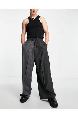 ASOS Extreme wide leg smart pants in stripe splice
