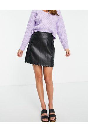 Morgan PU mini skirt with scallop edge detail in