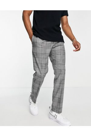River Island Pleated slim check suit pants in