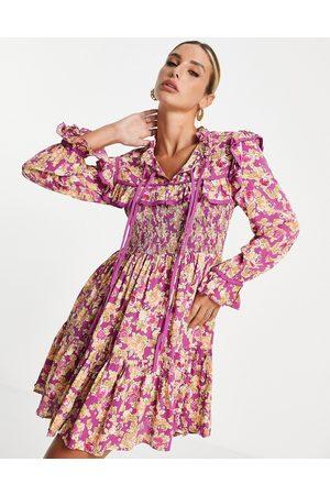 River Island Long-sleeved shirred yoke mini dress in pink floral-Purple
