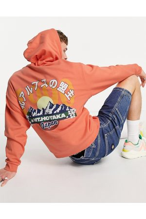 ASOS Oversized hoodie in orange with mountain back print