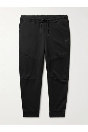 Nike Sportswear Tapered Logo-Print Cotton-Blend Tech-Fleece Sweatpants