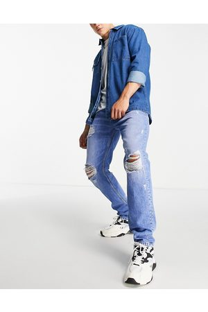 Tommy Hilfiger Ethan relaxed straight fit heavy distressed jeans in light wash-Blue