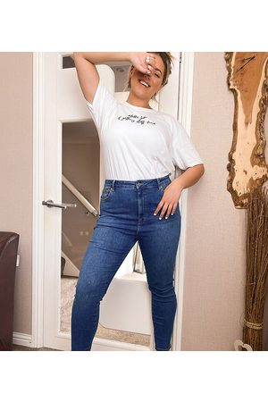 ASOS ASOS DESIGN Curve high rise 'lift and contour' 'skinny' jeans in mid blue wash