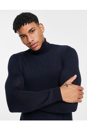 ASOS Muscle fit merino wool roll neck jumper in