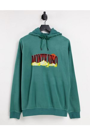 ASOS Oversized polar fleece hoodie with mountain embroidery in green