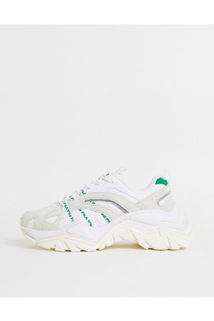 Fila Interation trainers in off white and green