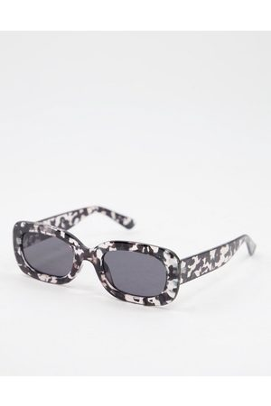 Jeepers Peepers Womens oval round sunglasses with black ink pattern in transparent