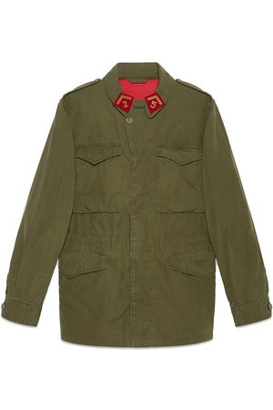 Gucci Men Parkas - Coated parka with logo